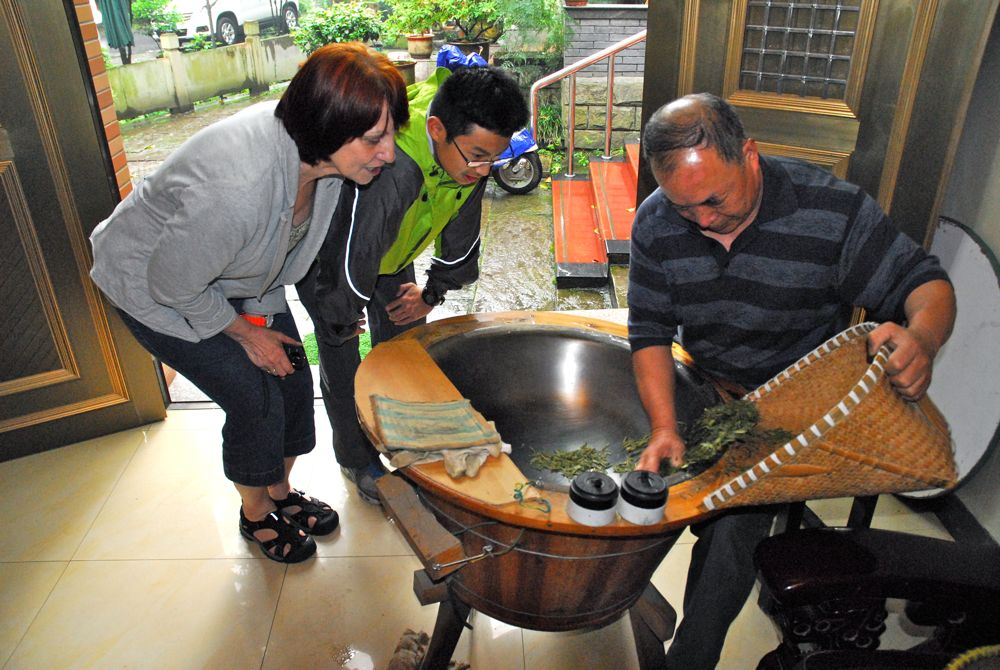 Xu Shun Hao roasts Long Jing Tea in his house as Char and one of her students, Stoney, look on.  Stoney is the son of Rong Rong Lu and Rocky Wu, our hosts during our trip to the Long Jing Tea village.  I am not a tea drinker, but this stuff was pretty good.  Quite mild.  Very tasty.