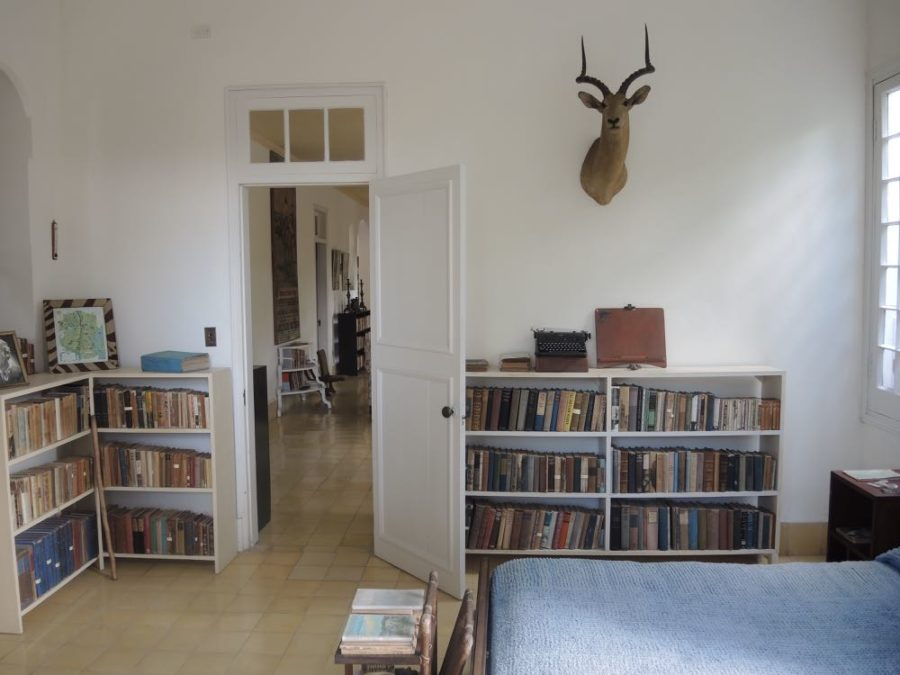 This is Ernest Hemingway's bedroom at Finca Vigia, his home in Cuba. Because of a war injury, Hemingway preferred to write standing up. Note the portable Royal typewriter on the bookcase.