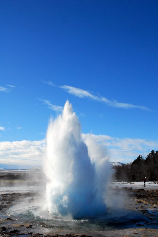 The geyser, Strokkur, erupts and is about to toss a water plume over 100 feet into the air. Some of the fun of a visit to Iceland is watching these guys leap out of the ground. Strokkur puts on a display every five to eight minutes. Here it is just starting to erupt.
